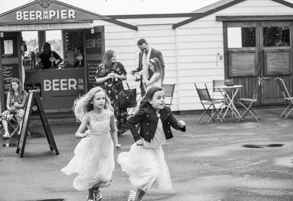 children running at Herne bay wedding venue
