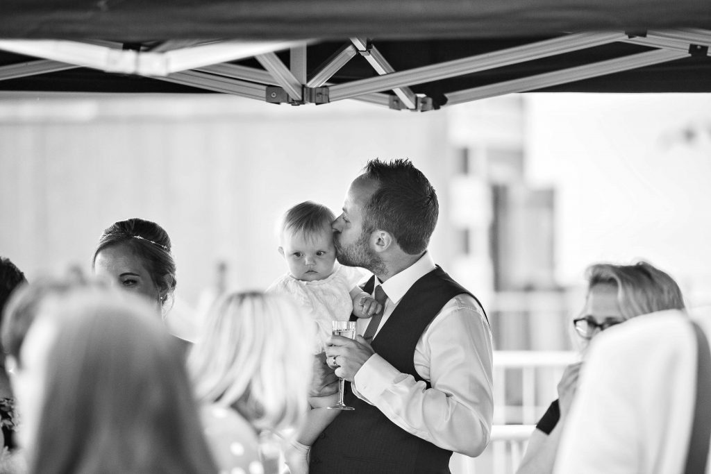 groo with baby at Herne bay wedding