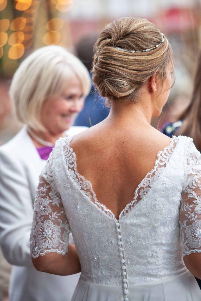 detail shot of back of brides dress