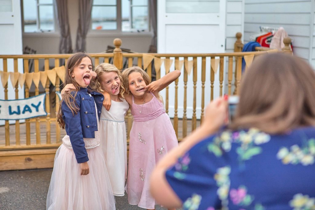 children pulling faces at a wedding