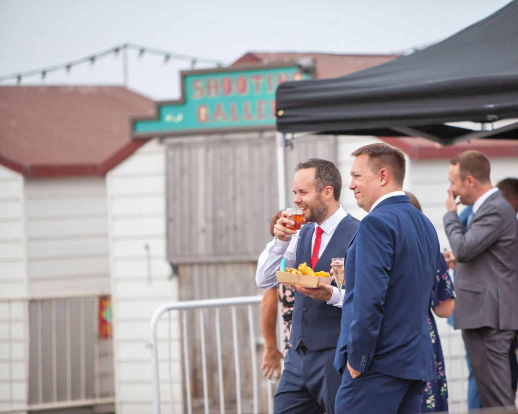 groo eating and drinking at Herne bay pier wedding