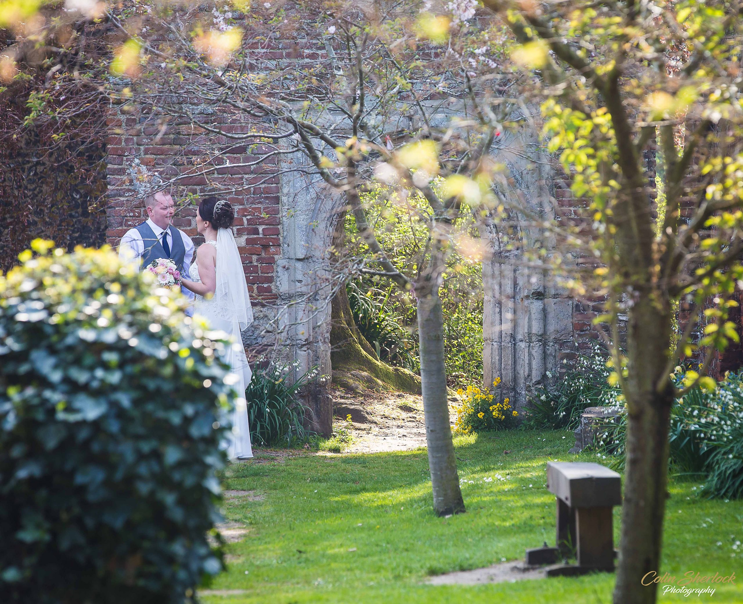 bride and groom in Greyfriars gardens in Canterbury