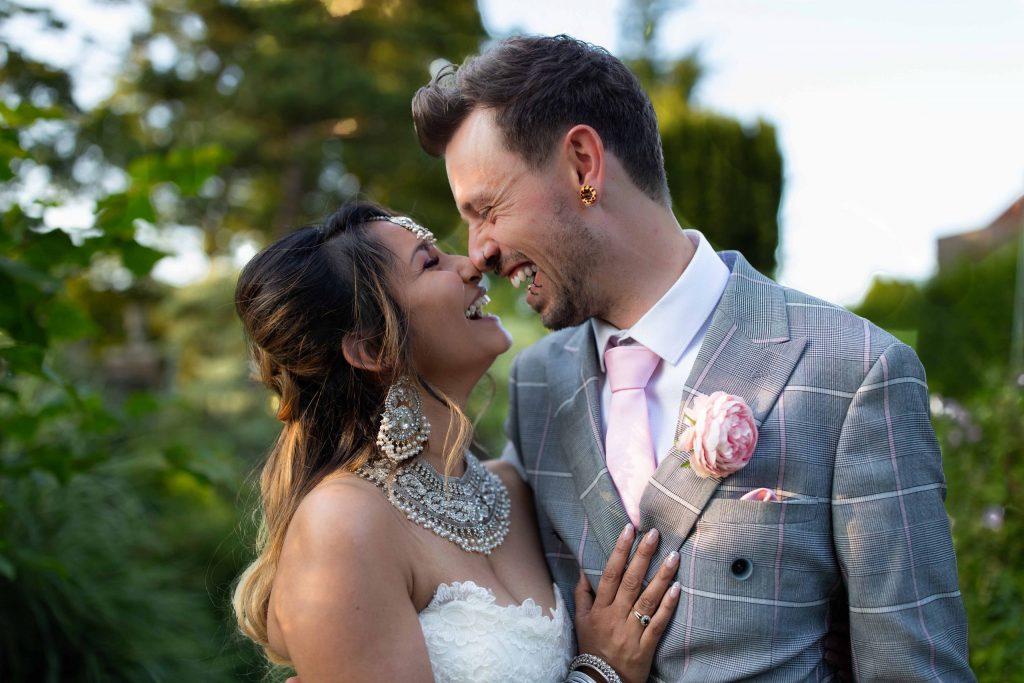 wedding portrait of bride and groom smiling