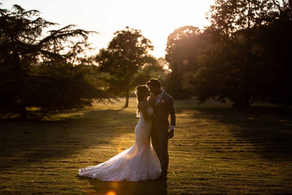 wedding portrait at sunset in swarling manor gardens
