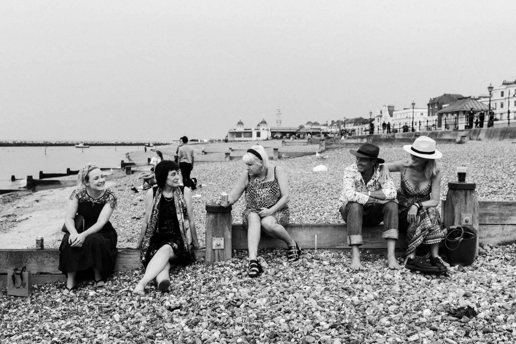 wedding guests on Herne Bay beach