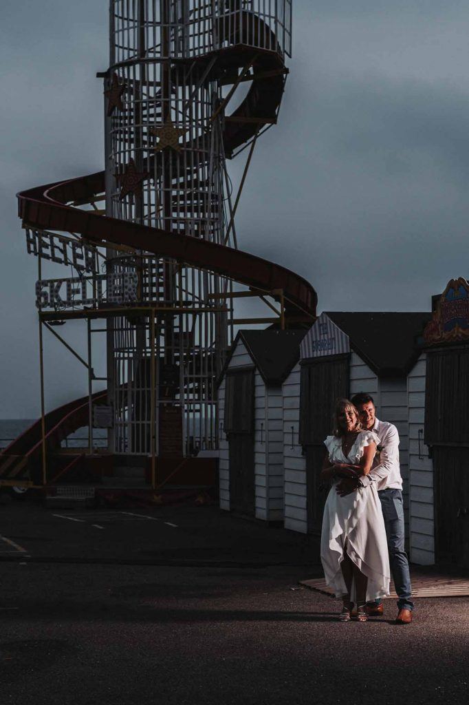 bride and groom portrait at beach hut weddings on Herne Bay pier