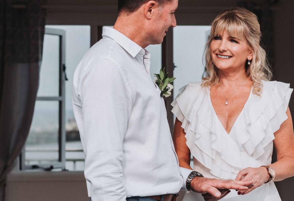 bride and groom at beach hut wedding ceremony