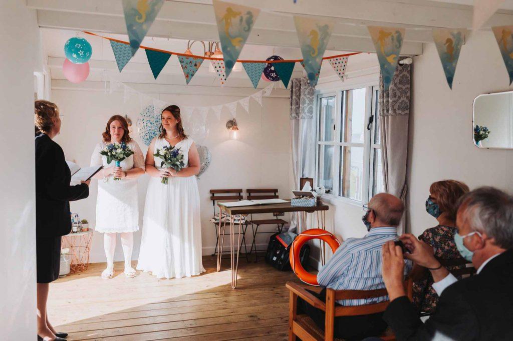 same sex wedding at beach hut wedding venue in herne bay