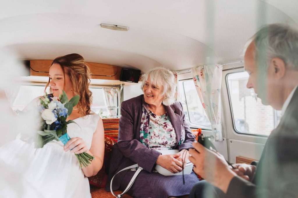 bride with family in wedding campervan