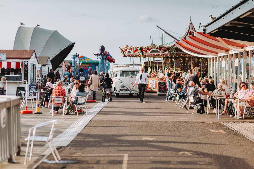campervan on herne bay pier leaving beach hut weddings venue