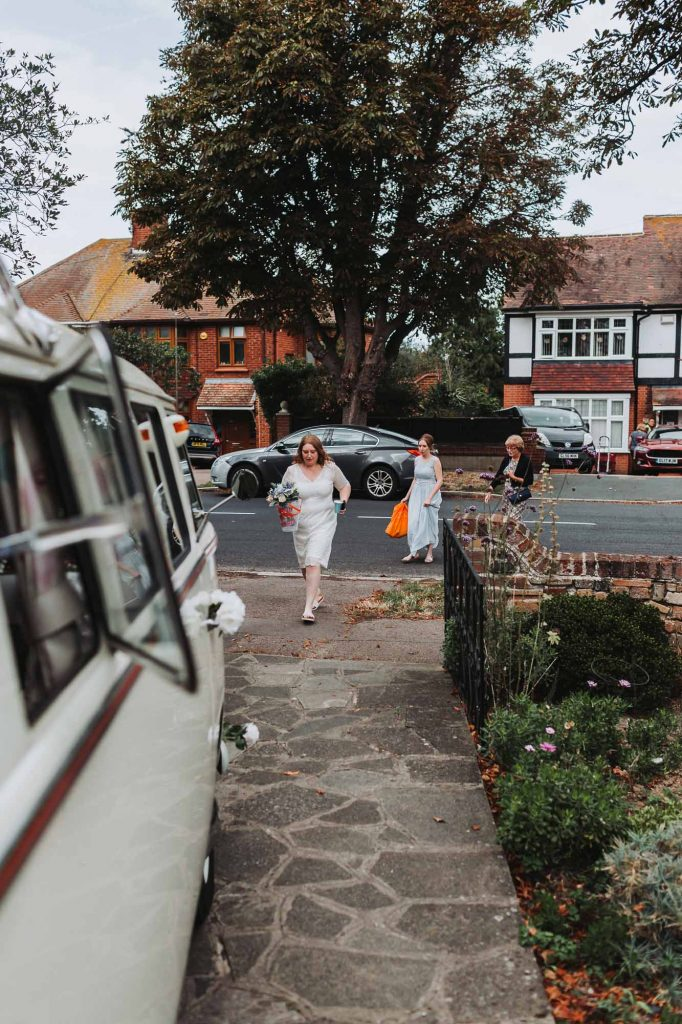 bride getting ready to leave in campervan