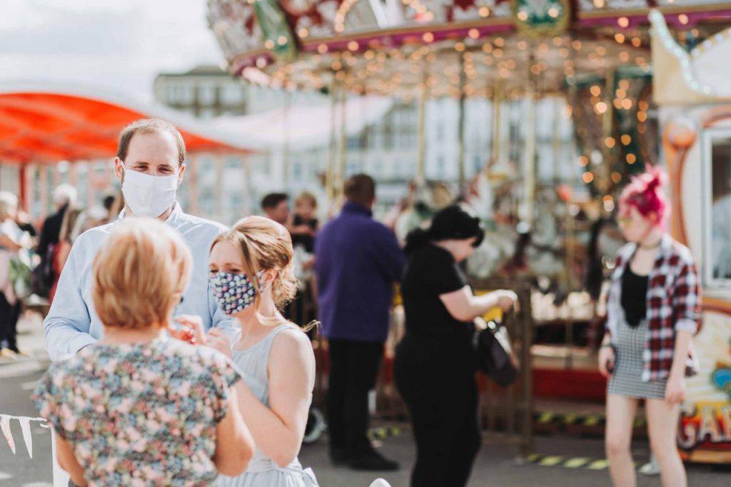wedding guests wearing masks at beach hut wedding on herne bay pier