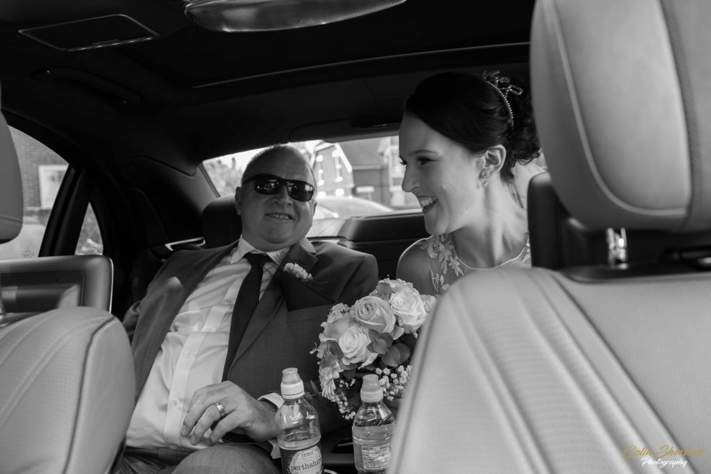 father and daughter in wedding car