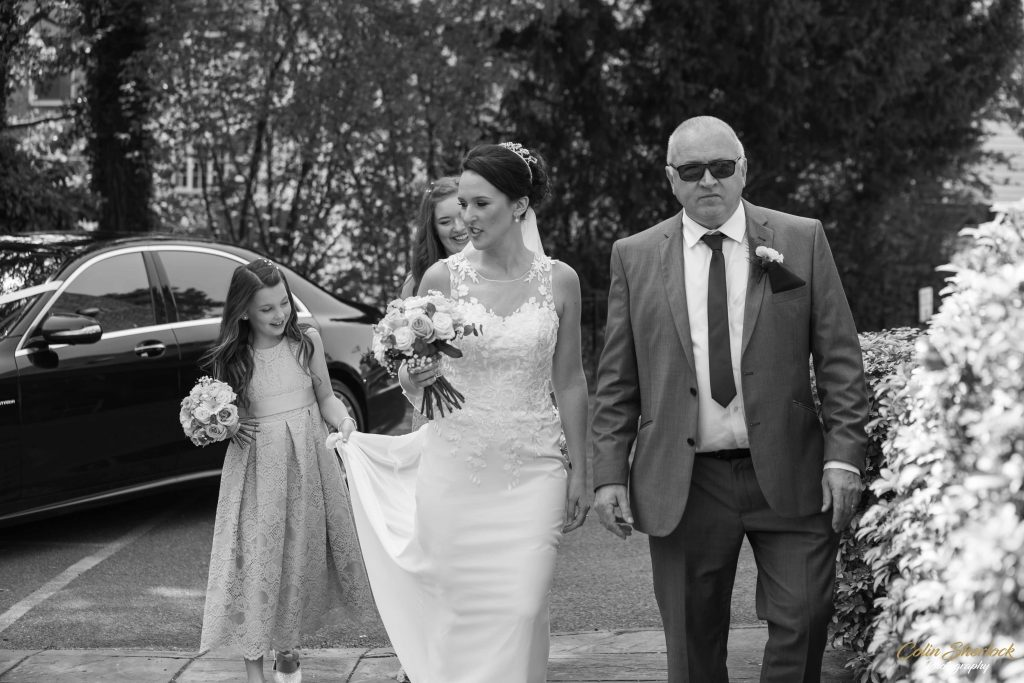 father, daughter and bridesmaids