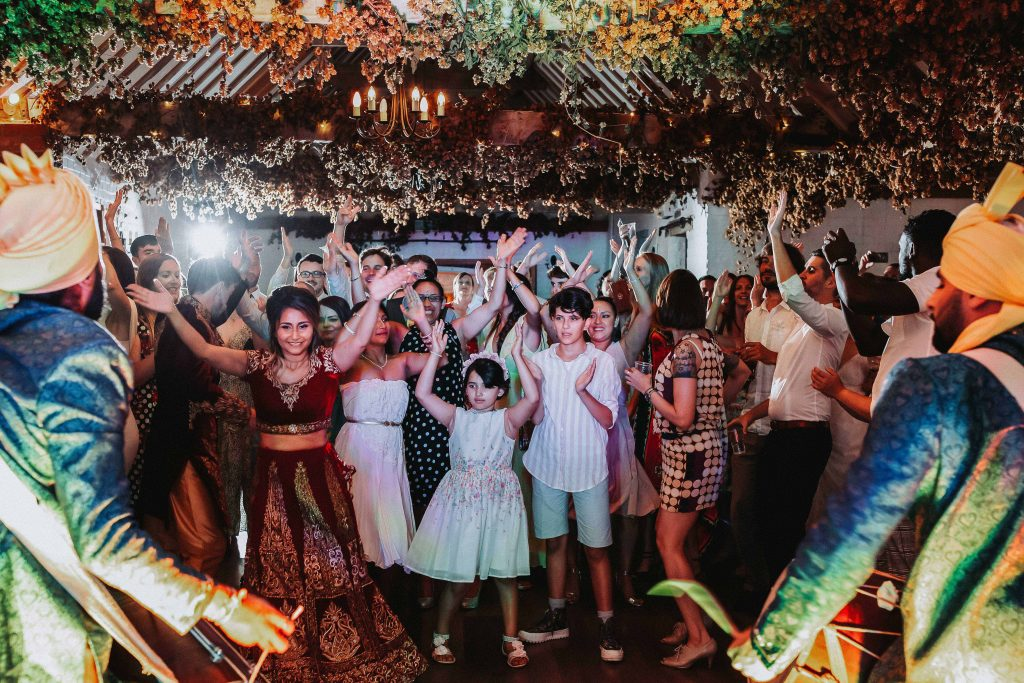 wedding reception dancefloor with dhol drummers