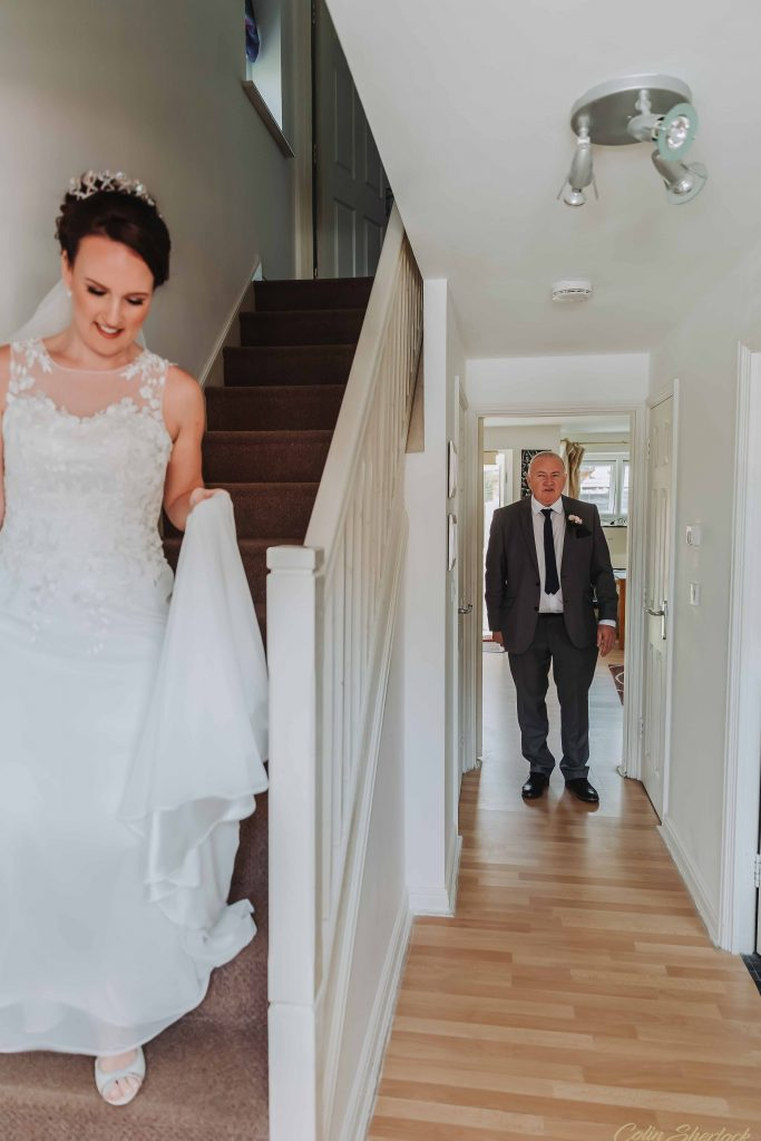 bride about to show her father her wedding dress for first time