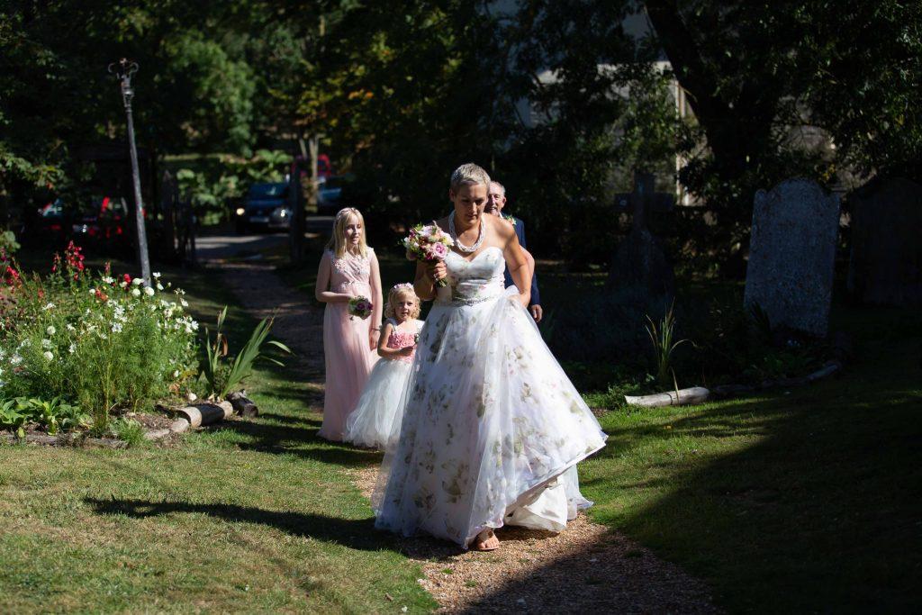 bride with bridesmaids walking