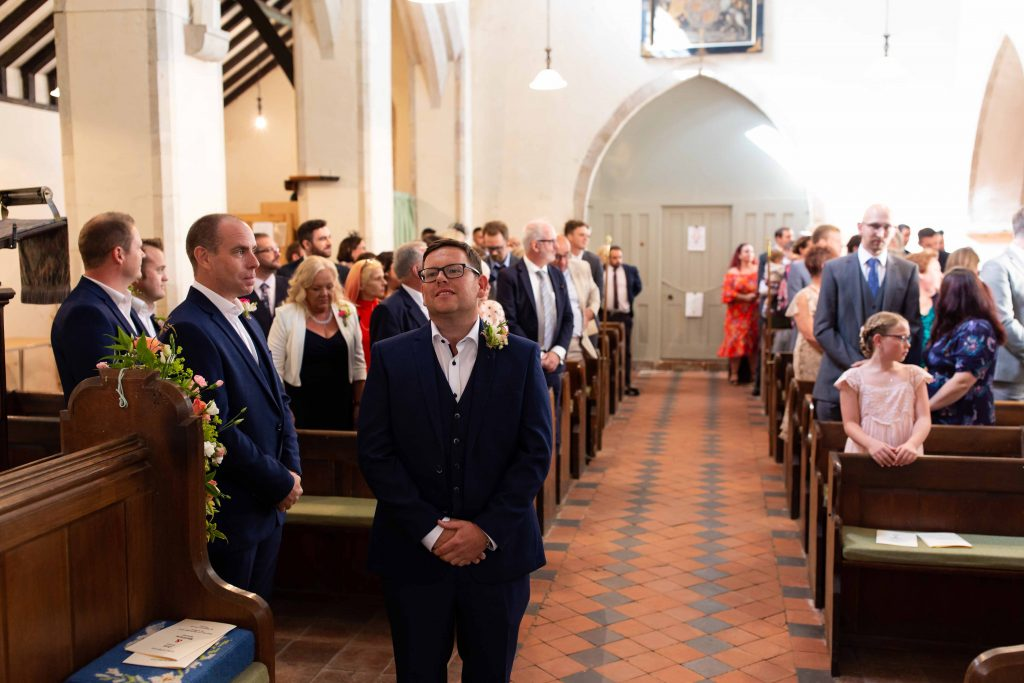 groom waiting for bride to enter in church