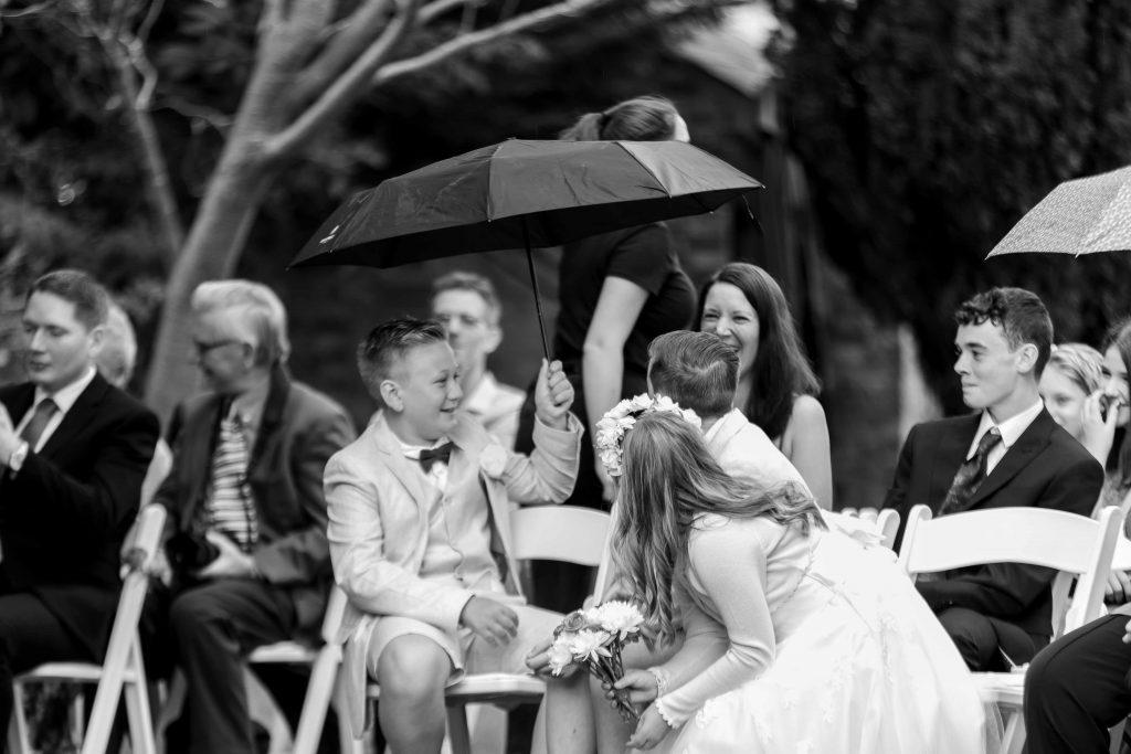 umbrellas at outside wedding ceremony