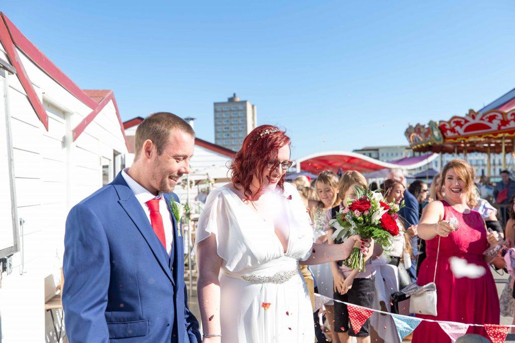 bride and groom on herne bay pier