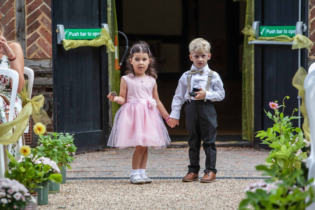 boy and girl as ring bearers at wedding