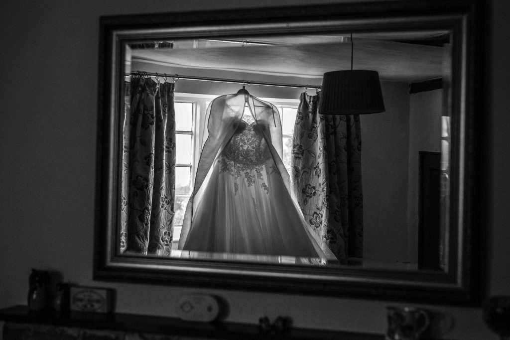 dress hanging up reflected in mirror