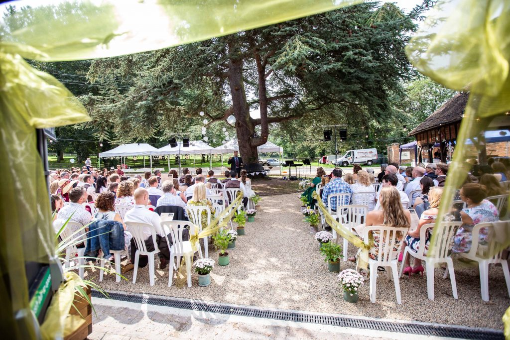 guests seated outside at Chilham village hall wedding