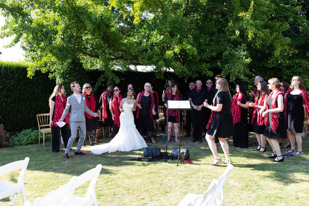 bride and groom singing with choir
