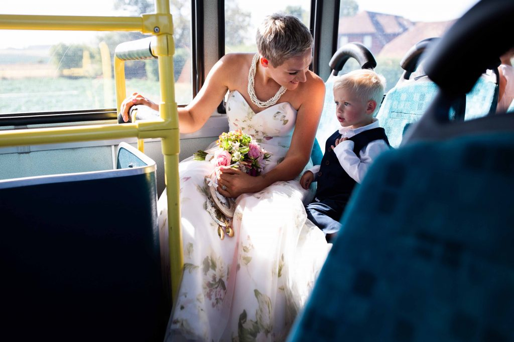 bride and young son on wedding bus
