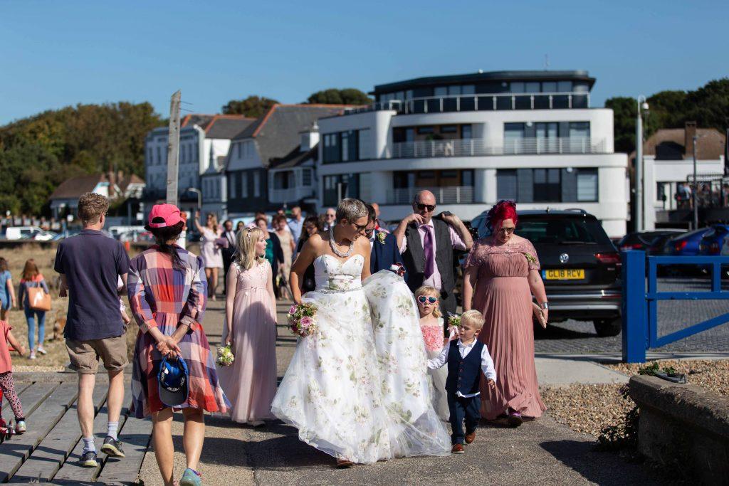 wedding party walking on Whitstable beachfront