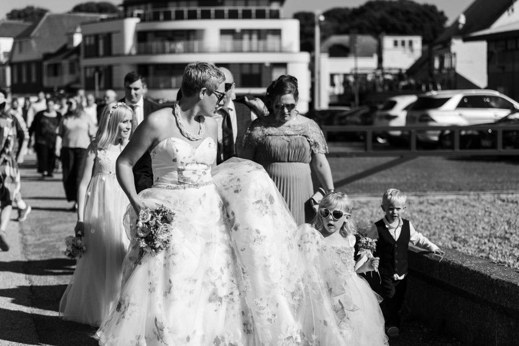 Wedding portrait walking on Whitstable beachfront