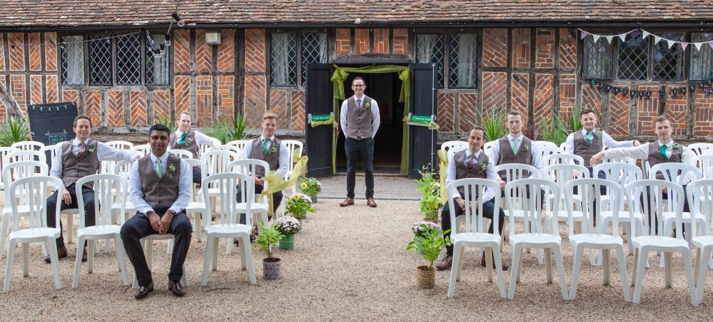 groomsmen posing with groom at Chilham village hall