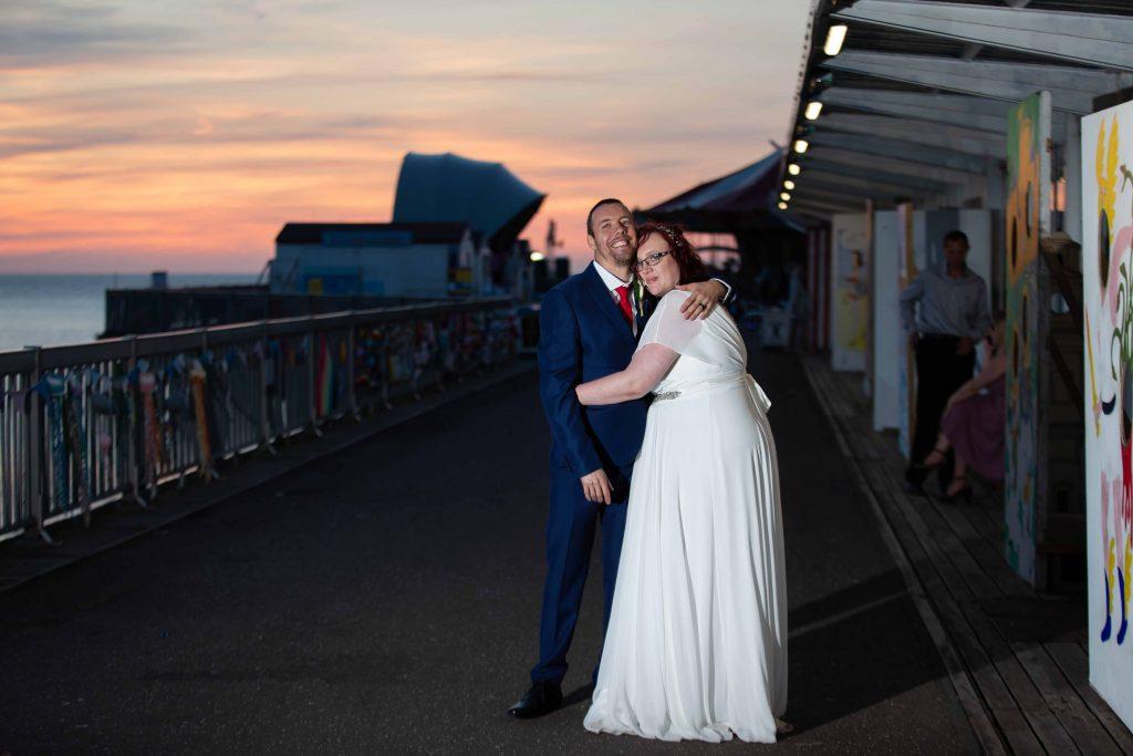 bride and groom flash portrait on herne bay pier