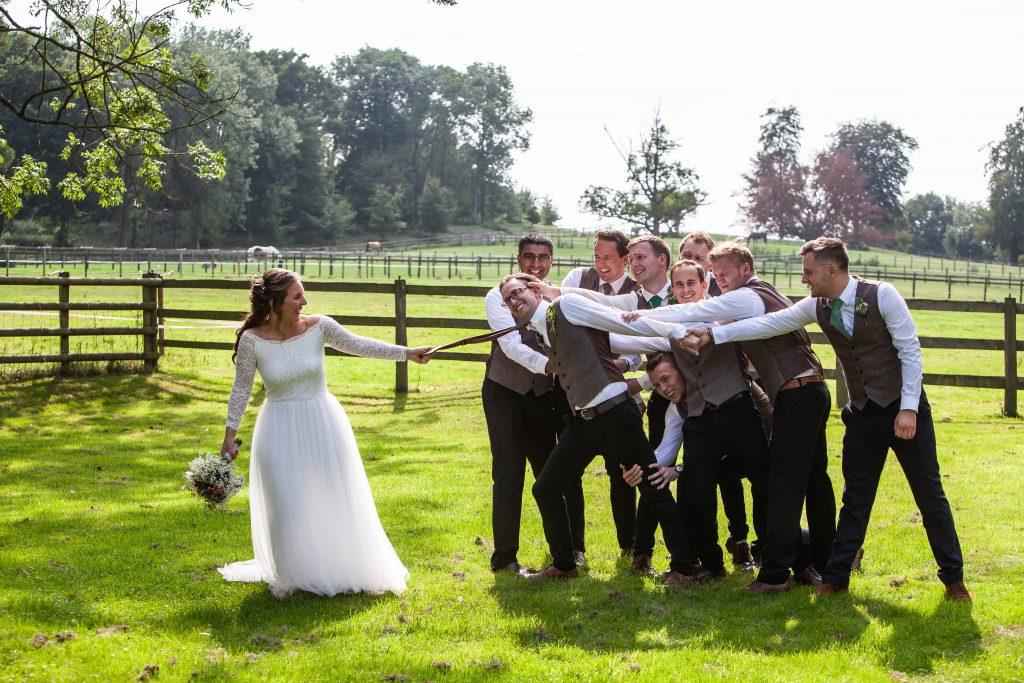 bride with groom and groomsmen