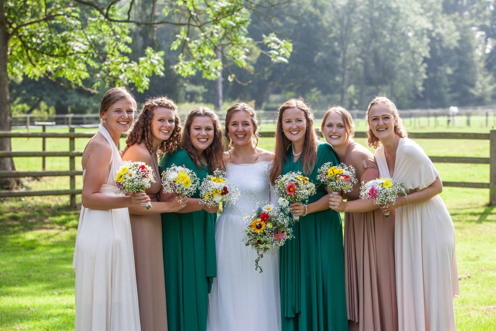 bride with bridesmaids at Chilham village hall