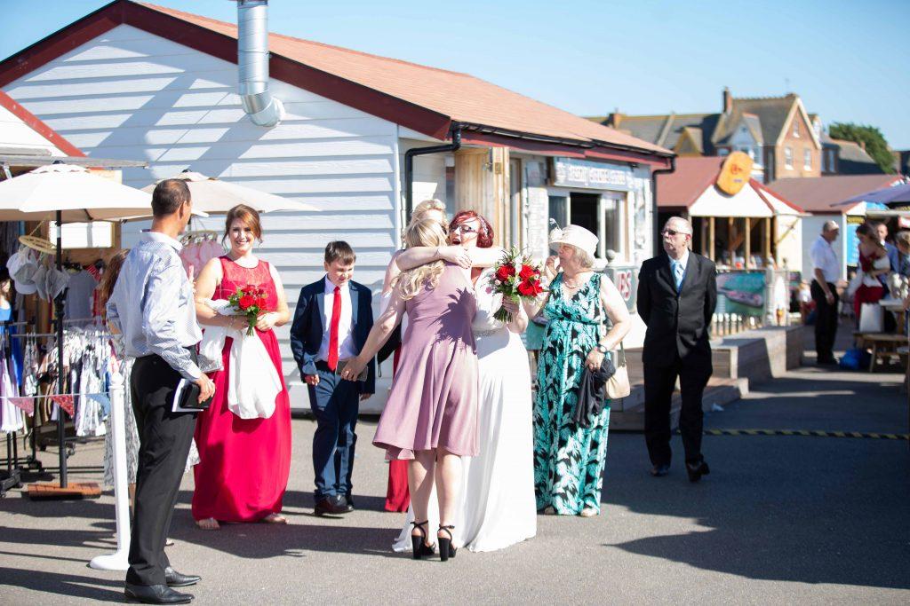 wedding guests at beach hut wedding venue on Herne bay pier