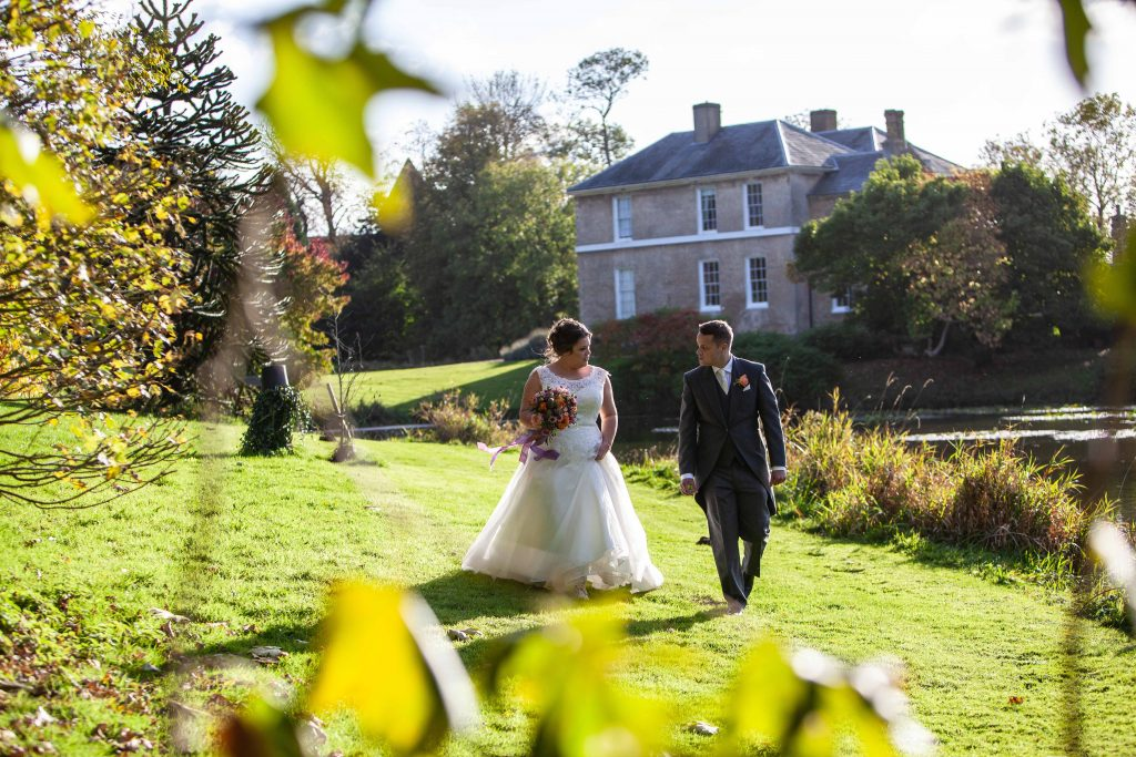 bride and groom in grounds of Preston Court