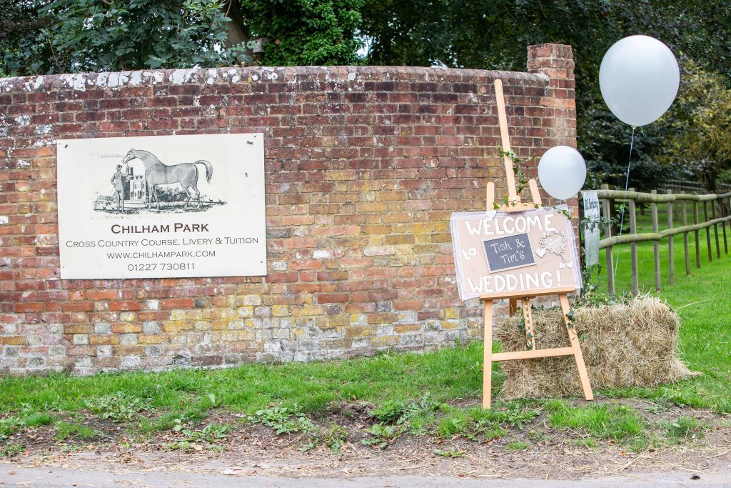 sign post for Tish and Tim's wedding at Chilham village hall