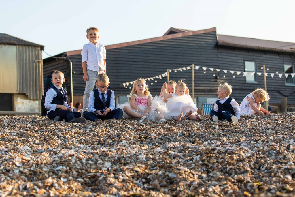 children on beach together at wedding at East Quay venue