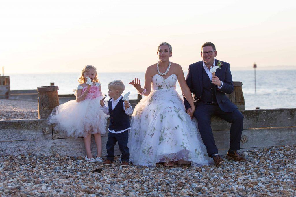 informal wedding family portrait on beach