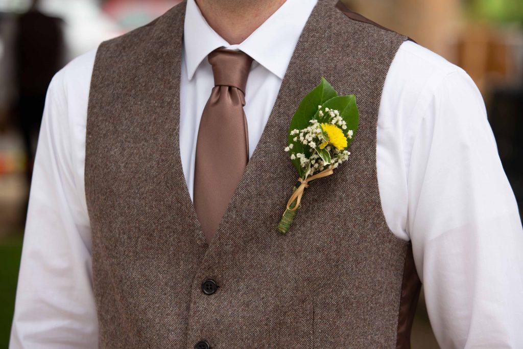 button hole flower on groom