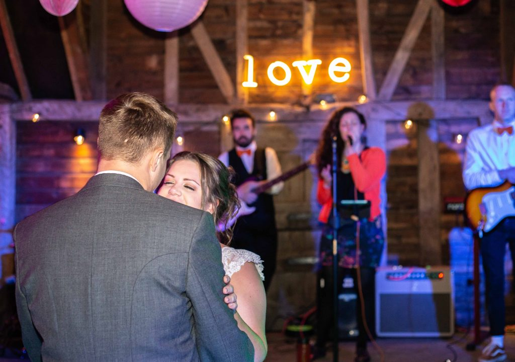 bride and groom first dance in main barn at preston court
