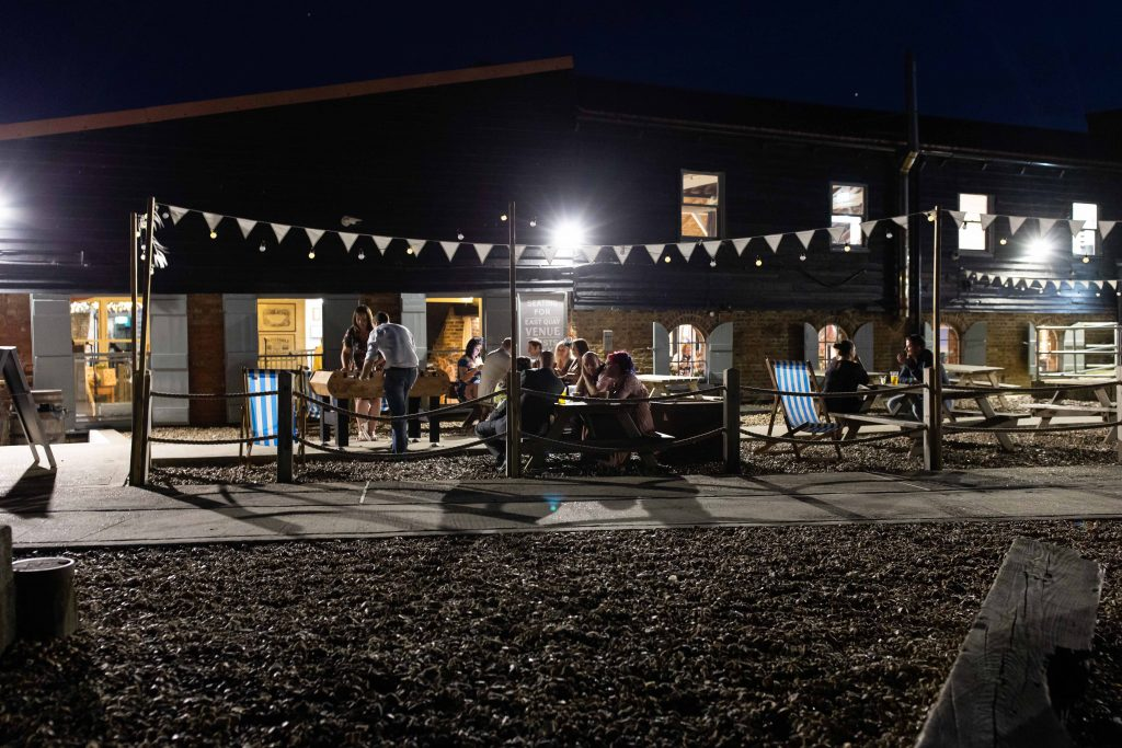 east quay wedding venue at night with guests outside