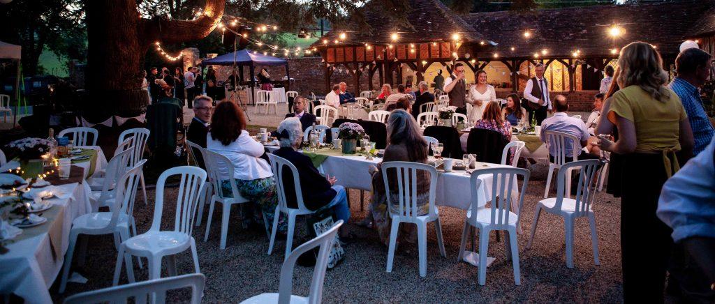 outdoor wedding reception at night under lights at chilham village hall