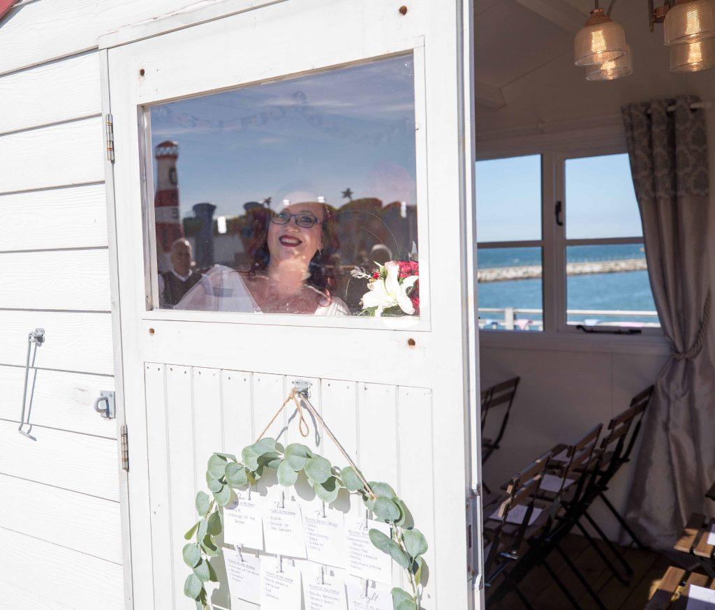 bride in beach hut wedding venue