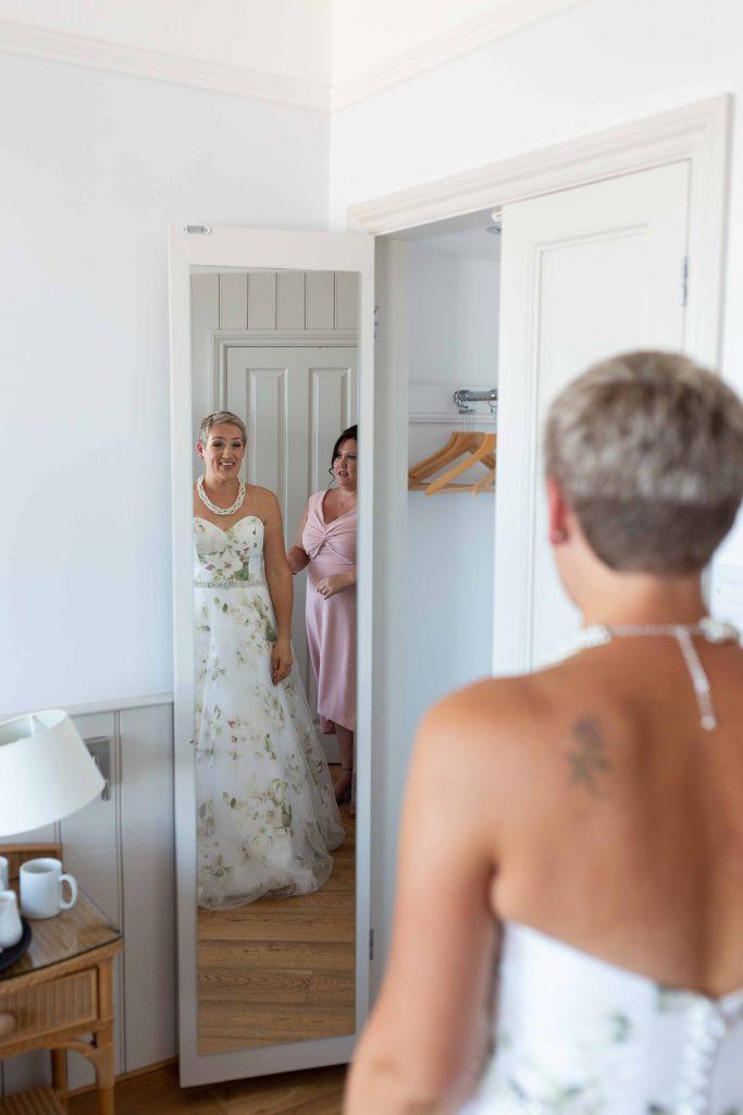 bride seeing dress in mirror