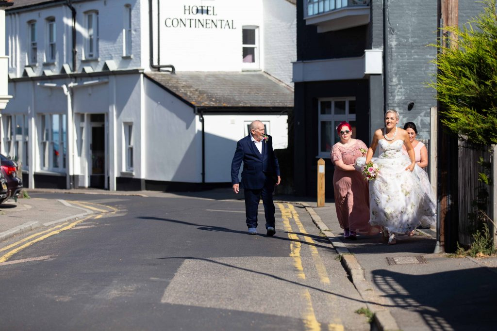 bridal party leaving Hotel Continental in Whitstable