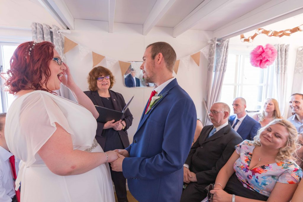 wedding ceremony at beach hut weddings