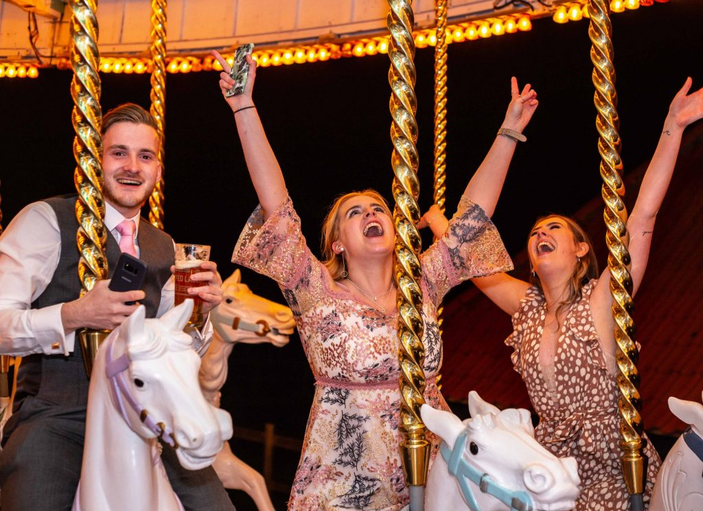 wedding guests on carousel at Preston court