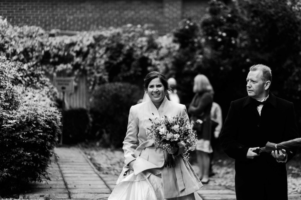 bride and groom leaving regitry office now married with guests